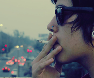 boy, piercing, and smoke image