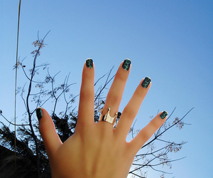 hand, sky, and nails image