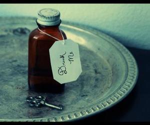 alice in wonderland, drink me, and key image
