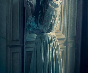 girl, key, and door image