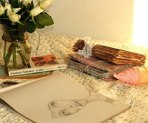 artwork, books, and floral image