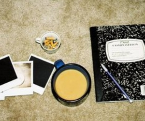 cigarettes, notebook, and polaroid image
