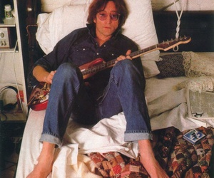 bed, lying, and guitar image
