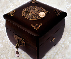 carvings, jewelry box, and key image