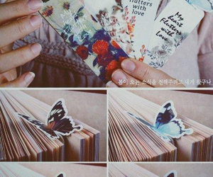 book, butterfly, and bookmark image