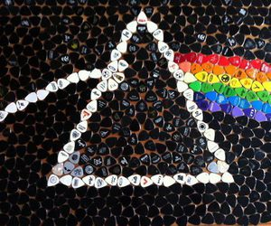 Pink Floyd, guitar pick, and rainbow image