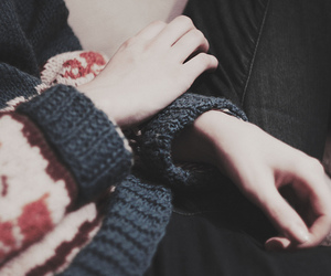 hands and sweater image