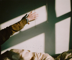 bed, hand, and light image