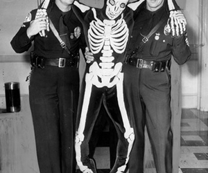 black and white, photograph, and police officers image
