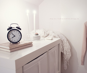 alarm clock, candles, and clothes image