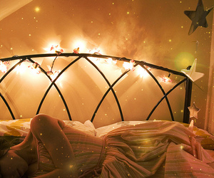 light, stars, and bed image