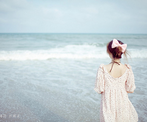 girl, sea, and bow image