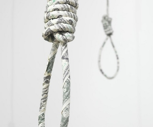rope, noose, and money makes the world go round image