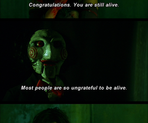 saw, blood, and jigsaw image
