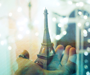 eiffel tower, hand, and light image