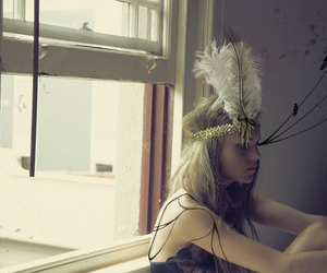 feather and window image