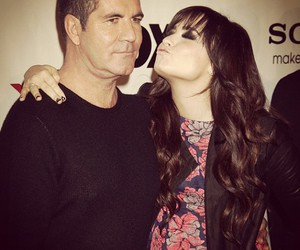 demi lovato, kiss, and simon cowell image