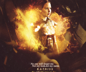 fire girl and kattnis. the hunger games image