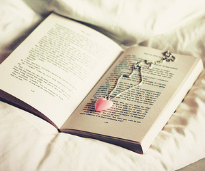 book, heart, and necklace image