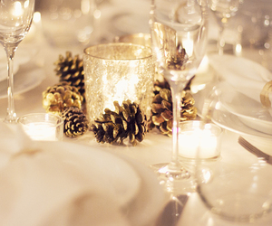 candles, gold, and pinecones image