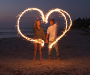 beach, sparklers, and love image