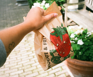 arm, paper bag, and strawberry image