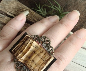 book, ring, and notes image