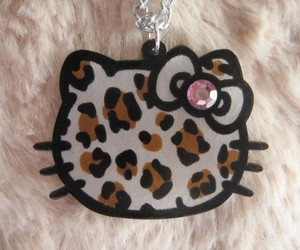 hello kitty, leopard, and bow image