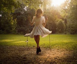 girl, swing, and dress image