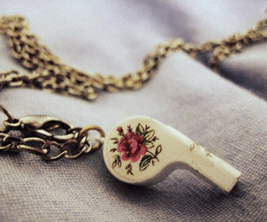 whistle, chain, and floral image