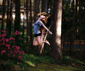 girl, jump, and forest image