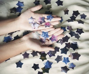 stars, hands, and galaxy image