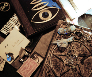 books, eye, and pentagram image
