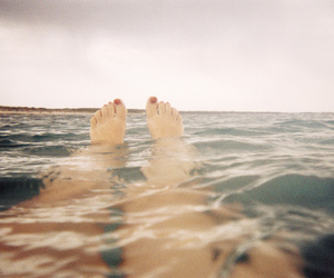 sea, legs, and ocean image