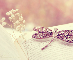 book, flowers, and dragonfly image