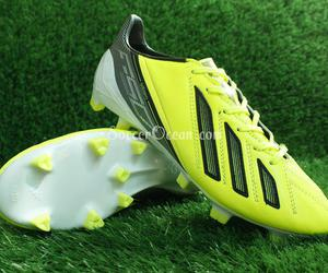 messi soccer cleats and fg f50 soccer shoes image
