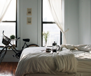 bike, bed, and bedroom image
