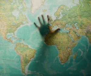 world, hand, and map image