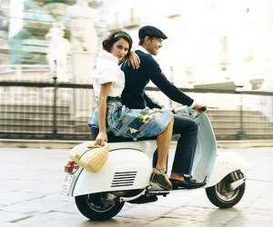 couple and scooter image