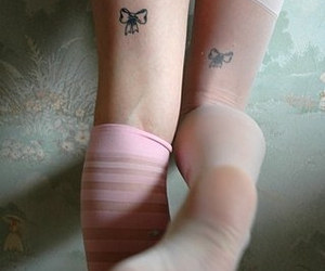 tattoo, bow, and legs image