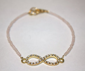 beaded, gold, and infinity image