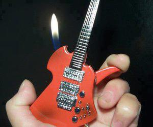 fire, guitar, and lighter image
