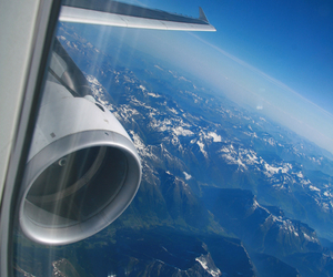 airplane, sky, and mountains image