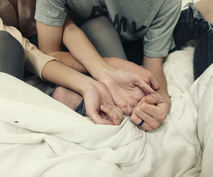 bed, hands, and couple image