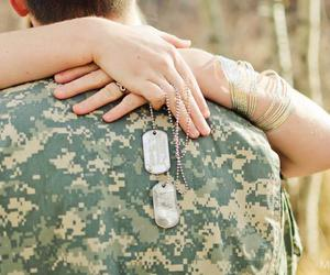 couple and soldier image