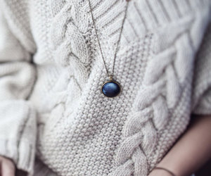 sweater, book, and necklace image