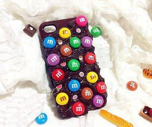 iphone, m&m, and chocolate image