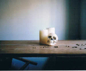 candle, skull, and table image