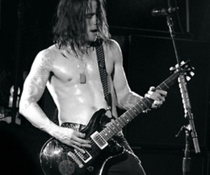 myles kennedy, alter bridge, and guitar image