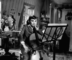 audrey hepburn, cello, and music image